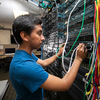 profile view of male ucf student working with wiring