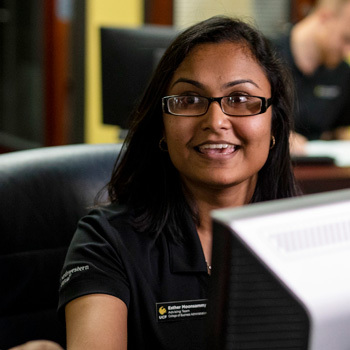 ucf undergraduate admissions employee smiling while helping someone off camera