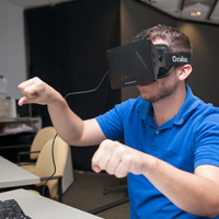 male ucf student testing virtual reality headset