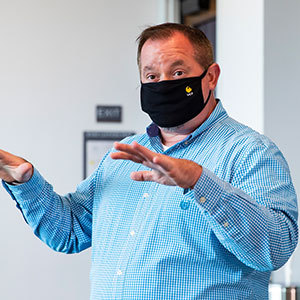 Faculty member in class with UCF face mask