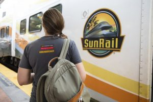 Picture of student and Sunrail train
