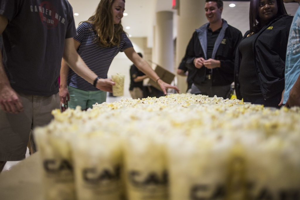 students with popcorn