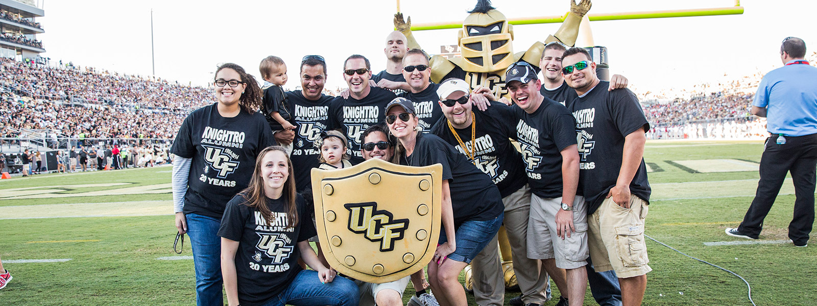 group of ucf students standing together on the football field