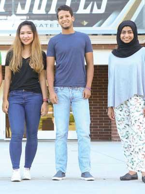 three international ucf students smiling at camera