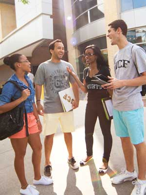 group of ucf students talking outside of a building between classes