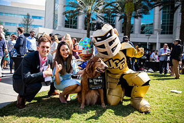 Knightro posing with students on UCF College of Medicine Match Day