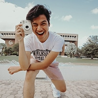 Male student holding a camera