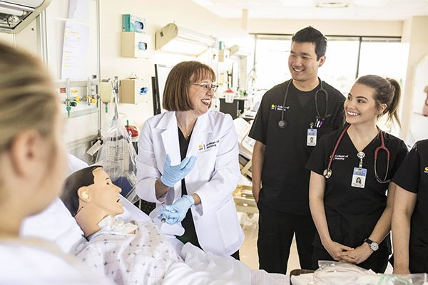 UCF Nursing professor teaches nurse practitioners using an advanced simulation system