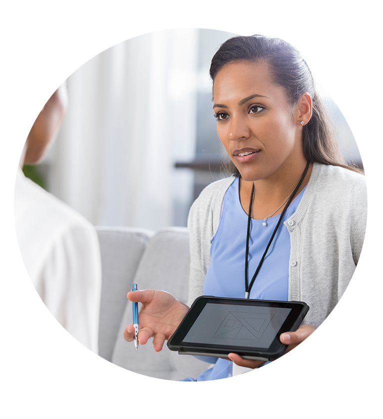 Woman holding tablet talking to patient