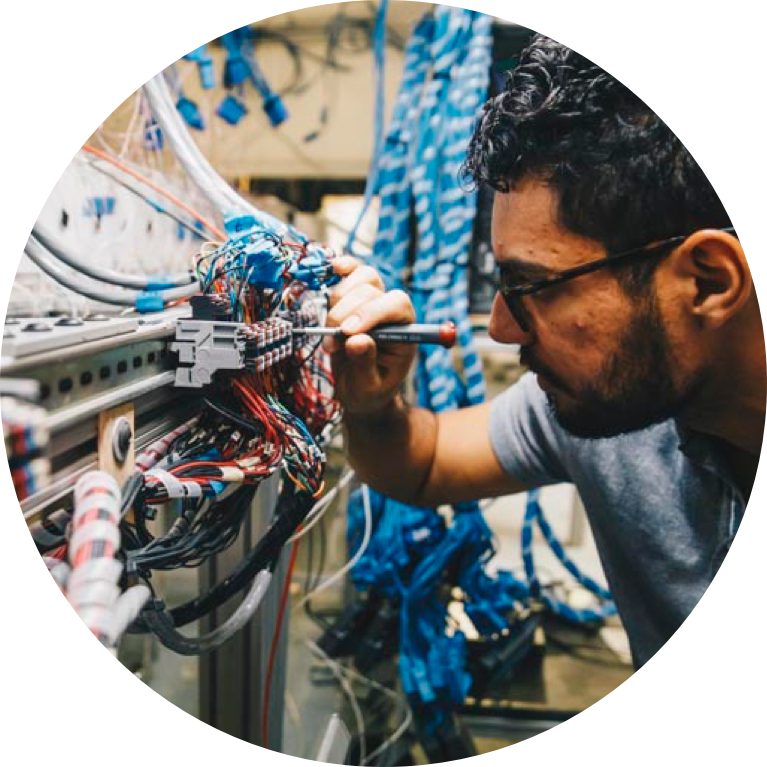 Electrical engineering student working on wires and cables