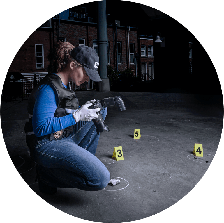 Crime Scene Analyst taking photos during an investigation