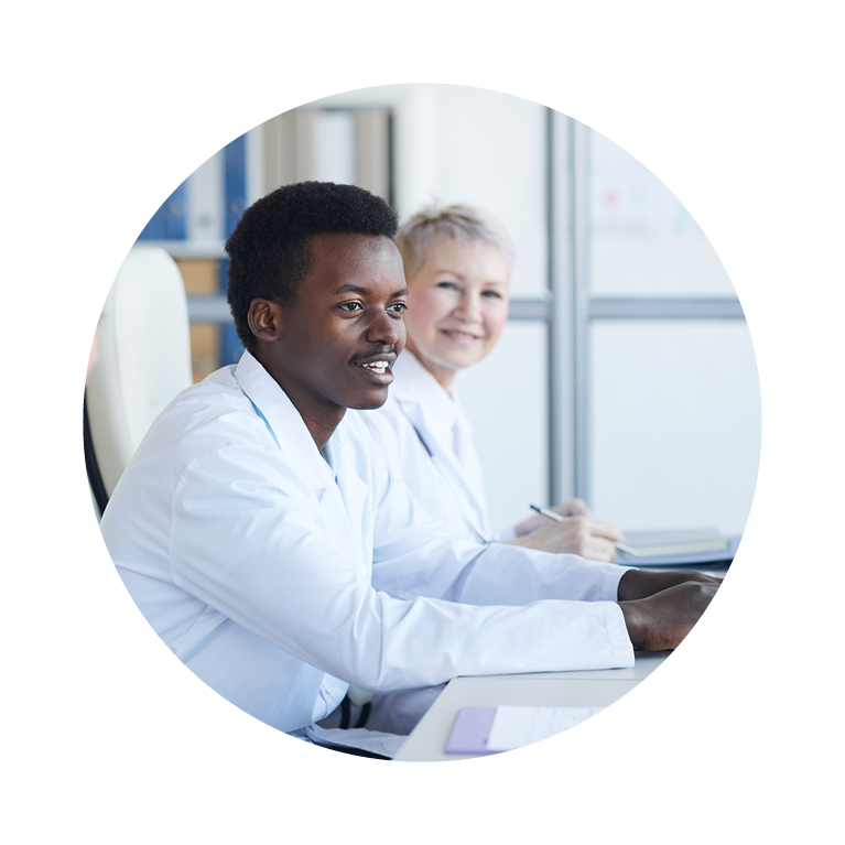 Health services administration professionals in office setting