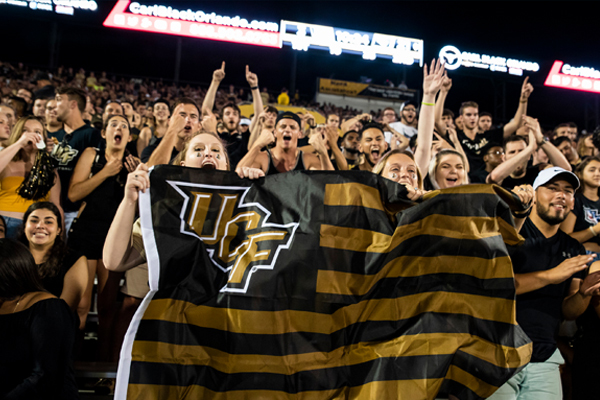 fans with UCF flag at sports game
