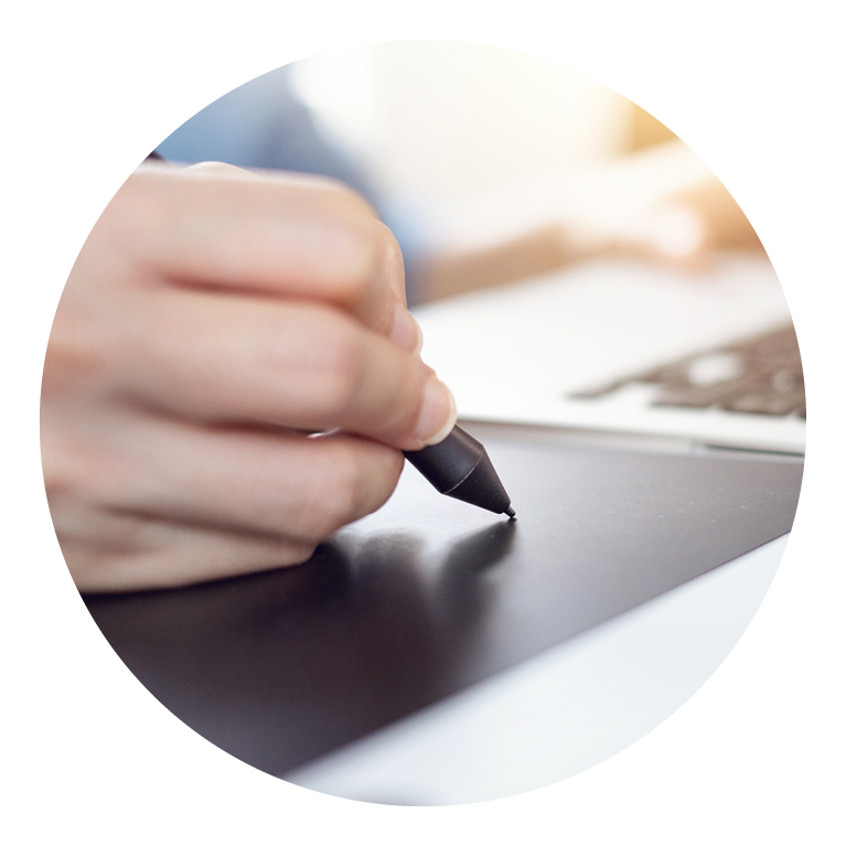 Person's hand writing on a touchpad