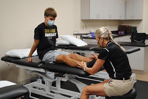 physical therapy session with expert treating a patient with an injury