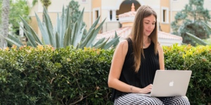 ucf student sitting outside with laptop