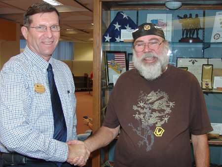 Left to right: James Middlekauff (Veteran Services Registrar's Office) and Harry Scholer (Vietnam Veterans of Central Florida)