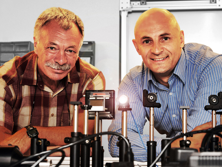 Professor Leon Glebov (left) of the College of Optics and Photonics founded OptiGrate in 1999. The company is now led by President and CEO Alexei Glebov.