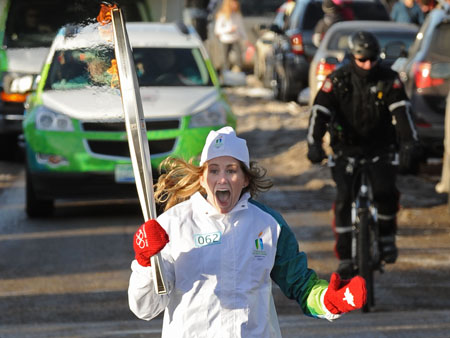 Kaitlyn Chana ran in Calgary on Jan. 19, carrying the Olympic flame on its way to the Opening Ceremonies in Vancouver.
