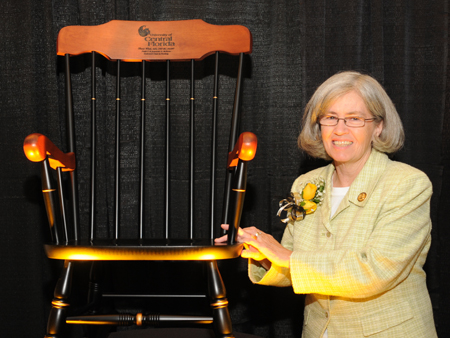 Dr. Diane Wink with her symbolically engraved rocking chair.