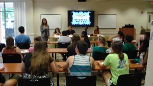 Assistant Vice President Chanda Torres talked to students at the social.