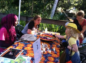 "Volunteers uKnighted LLC residents in Neptune greet children with candy at the ""Zoo Boo Bash"" held at the Central Florida Zoo."