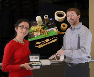 Nahid Mohajeri of UCF's Florida Solar Energy Center and Luke Roberson, Science Payload System Engineer with NASA's Kennedy Space Center, show some of the products HySense has produced with its proprietary hydrogen sensing tape.  The work that led to the tape began with a NASA KSC grant for hydrogen research.