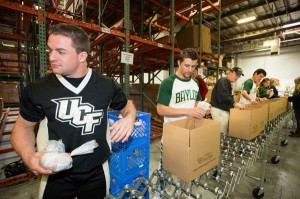 Jacob Serre helps to pack emergency food boxes. (Photo: Scott Mitchell Photography)