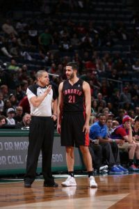 Referee Steve Anderson discusses a call with Greivis Vasquez of the Toronto Raptors. (Courtesy of NBA)