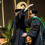 UCF Pride: Father Hoods Son At M.D. Graduation