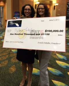 Hysense Technology CEO Nahid Mohajeri and Production Manager Monica Kowalczik accept the grand prize check of $100,000 for placing first in the CAT5 competition at Innovation Concourse of the Southeast 2014 in Orlando.