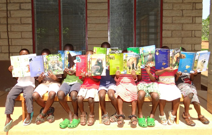 Rafiki primary students in Uganda enjoying library timeEDIT