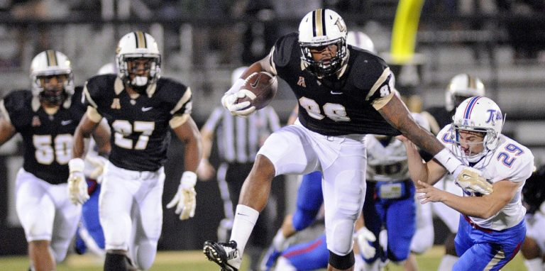 Nov 14, 2014; Orlando, FL, USA; UCF Knights wide receiver Jordan Akins (88) breaks the tackle of Tulsa Golden Hurricane place kicker Carl Salazar (29) during a kickoff return at Bright House Networks Stadium. Mandatory Credit: David Manning-USA TODAY Sports