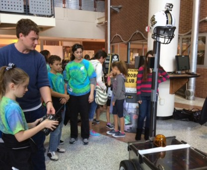 Football Players, Scientists Deconstruct Science Behind Football, Part of Colossal STEM Day Activities