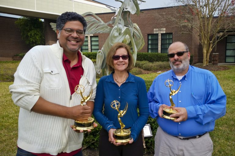"""""""The Committee"""" film editor Aaron Hose, and co-directors Lisa Mills, an associate professor of film, and Robert Cassanello, an associate professor of history, with their Emmys."""