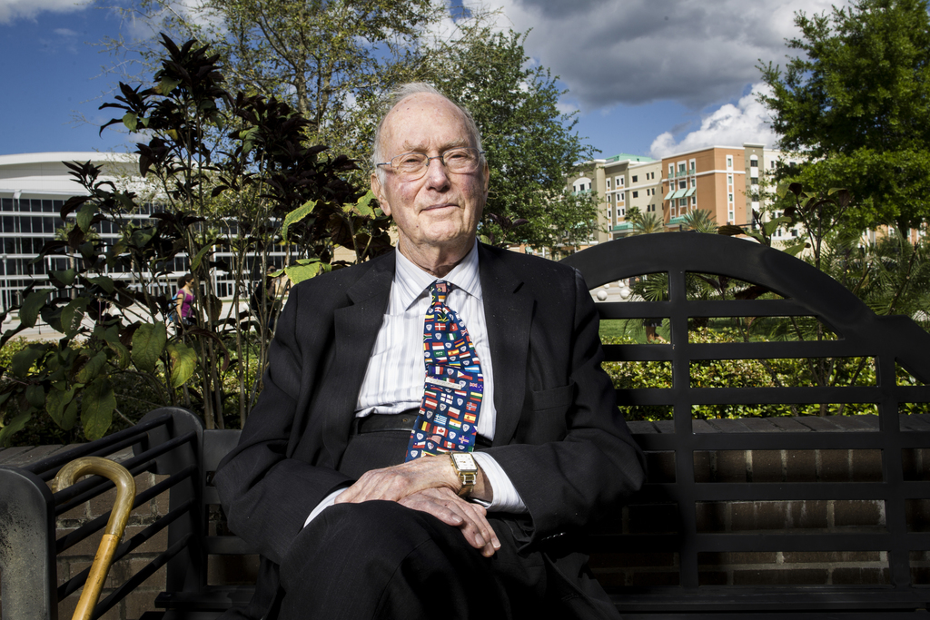Charles H. Townes poses on a park bench at UCF in 2012. The pose re-created a time in 1951 when Townes, seated on a park bench, came up with the theory behind the maser.