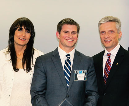 BMC winner Brandon Naids with Pam Hoelzle and Cameron Ford, Ph.D. of the UCF Blackstone LaunchPad.