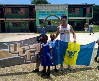 Delta Upsilon Member Helps Renovate School in Jamaica