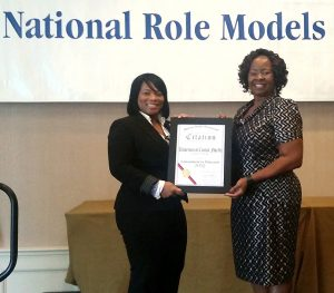 L-R: Tammie Nadeau, Multicultural Academic & Support Services and Belinda Higgs Hyppolite, Student Development and Enrollment Services, accepted the award on behalf of UCF.