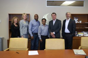"""The team from UCF's Office of Research & Commercialization (Office of Technology Transfer) celebrates the licensing agreement: Svetlana Shtrom, director, Andrea Adkins, assistant director, Brian Brackeen, CEO of Kairos, Narasimha Nagaiah """"Raju"""", licensing associate, Thomas O'Neal, associate vice president, and Rob Bernath, business development manager."""