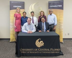 Celebrating the licensing agreement: (seated L to R), Thomas O'Neal, UCF and Sundar Muruganandhan, Versa Drives, along with members of UCF's Office of Technology Transfer (standing L to R) Andrea Adkins, Narasimha Nagaiah (Raju),  Durgasharan Krishnamurthy, Versa Drives, Svetlana Shtrom, and Shan Venkatachalam, Versa Drives.