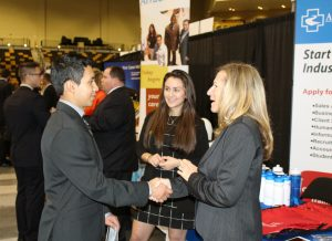 Student and employer greet one another at the Career Expo.