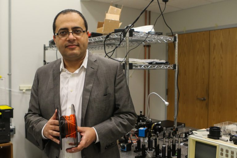 Ayman Abouraddy of UCF's College of Optics and Photonics is part of a $317 million program to produce high-tech textiles. Photo by Nick Russett/UCF