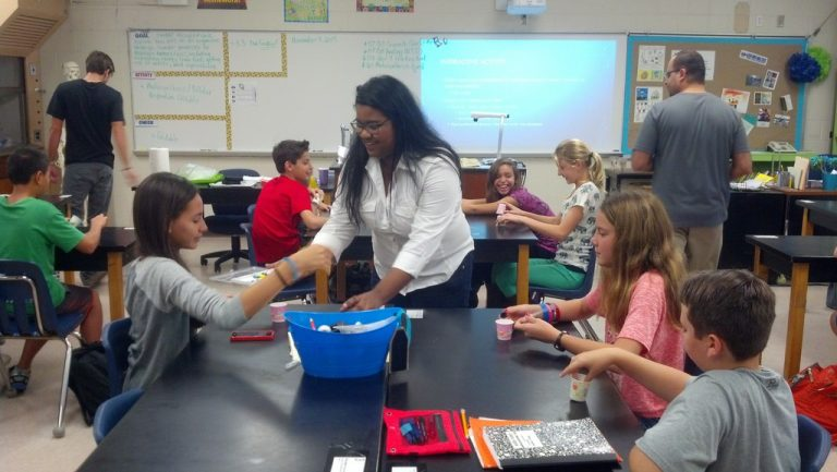 UCF student Dahlia Hurtado provides a lesson to science students at Jackson Heights Middle School in Oviedo as part of the service learning component of UCF's new nanoscience minor.