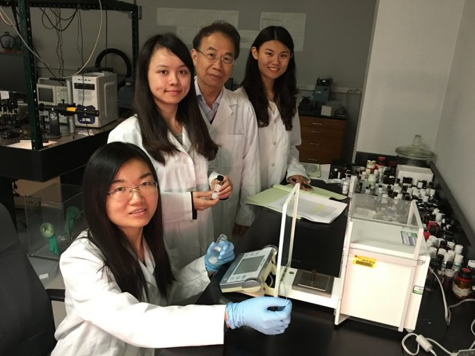 "Dr. Shin-Tson Wu and doctoral students work on new liquid crystal mixtures in his lab at the College of Optics & Photonics. From left, Fenglin Peng, Fangwang ""Grace"" Gou, Wu and Yuge ""Esther"" Huang."