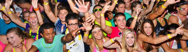 ucf students with glow sitcks partying