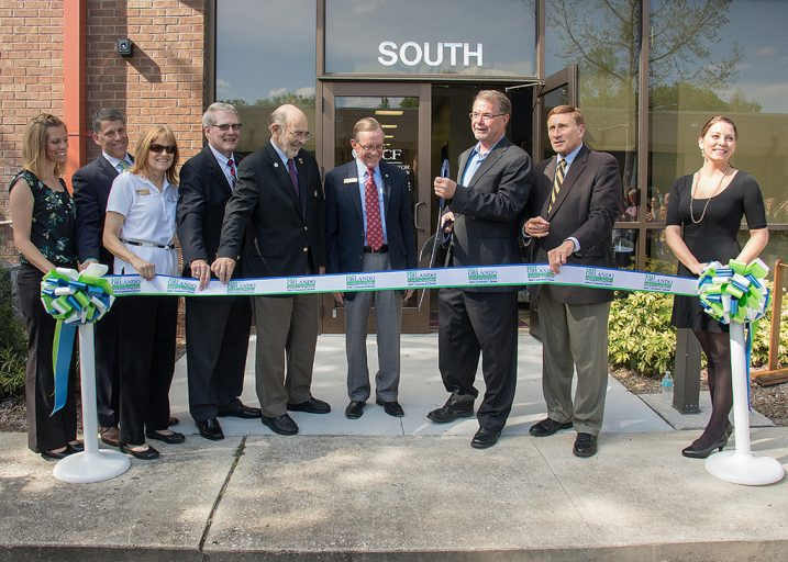 UCF representatives, local economic development and legislative officials cut the ribbon to celebrate the renovation and expansion of the Research Park incubator.