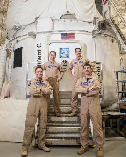 Courtesy of NASA: Crew members for the current simulation missions stand in front of the NASA Human Exploration Research Analog (HERA). HERA is a high-fidelity mission simulation environment operated by NASA's Human Research Program (HRP) at the Johnson Space Center.