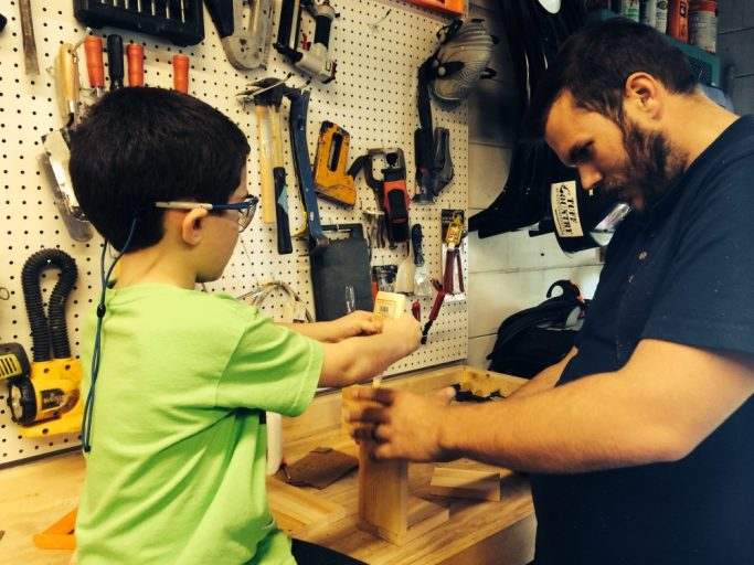 russell woodworking with his foster son