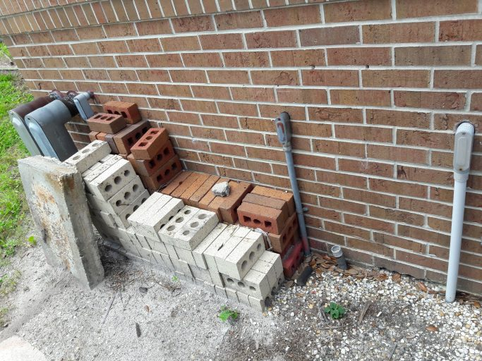 discarded pallets or other debris behind campus building